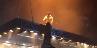 Kanye West Fan Climbs Stage